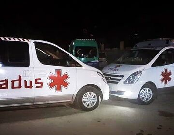Ambulances financed by CADUS standing in a parking lot of Heyva Sor, ready for deployment.
