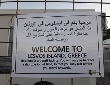 A welcome sign on a fence from a refugee camp at Lesvos