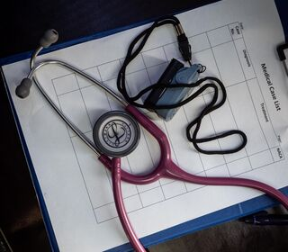 A medical case list with a stethoscope.